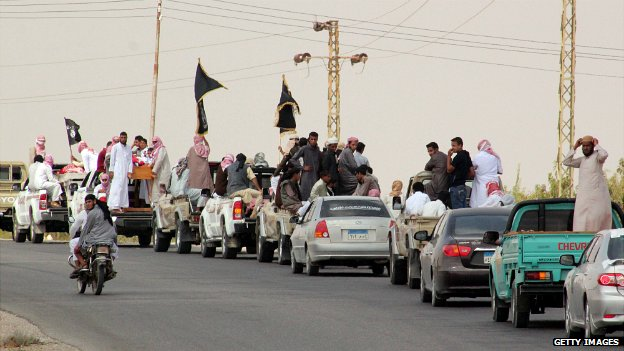 A funeral convoy carrying the bodies of four Egyptian militants in the Sinai peninsula - 10 August 2013