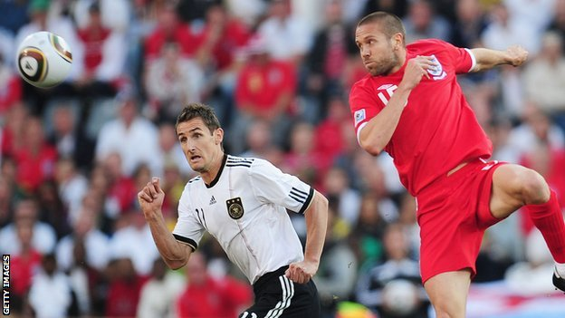 Matthew Upson wins a header playing for England against Germany in the 2010 World Cup