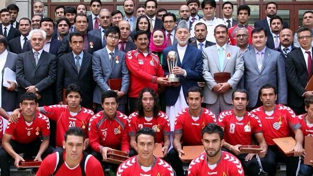 President Karzai holds the South Asia Cup trophy