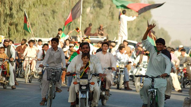 Cricket fans in Kandahar celebrate the Afghan team's qualification for the world cup