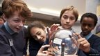 Cerys, Fatemah, Ieuan and Abdirahim  get a closer look at the plasma sphere