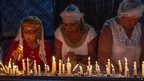 Pilgrims lighting candles in Djerba's Ghriba synagogue, Tunisia - Friday 16 May 2014