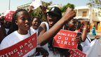 Women holding Bring Back Our Girls posters in Dakar, Senegal - Friday 16 May 2014