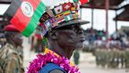 A man in a colourful hat attends an SPLA/M parade in Juba, South Sudan - Friday 16 May 2014