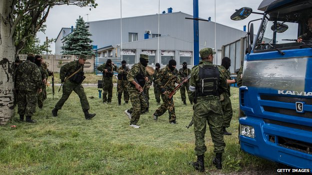 Members of the pro-Russia Vostok Battalion assemble along the side of the road following early morning clashes with pro-Ukraine fighters on 23 May 2014 in Pisky, Ukraine.