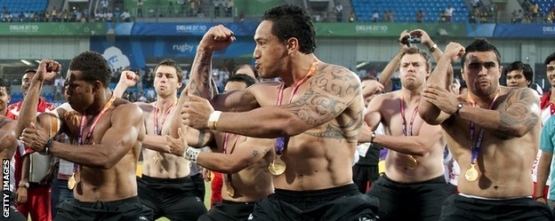 New Zealand's rugby sevens players perform a 'Haka' after winning gold  at the 2010 Commonwealth Games