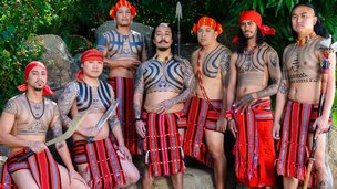 group of men with tribal tattoos