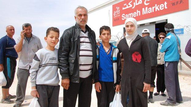 Qadiri family outside supermarket