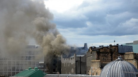 Smoke rises into the sky after a fire broke out at the Glasgow School of Art's Charles Rennie Mackintosh building