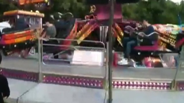 Still from footage of ride carriage tipping