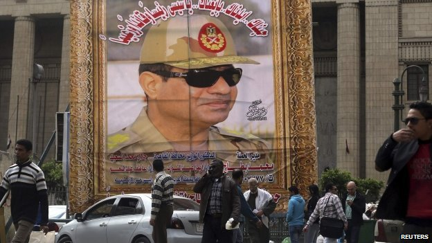 Poster showing Abdel Fatah al-Sisi in military uniform on side of building