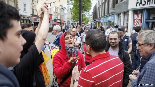 Crowds outside Whitgift Shopping Centre in Croydon chanted and waved posters whilst waiting for UKIP leader Nigel Farage on May 20, 2014 in Croydon, England.
