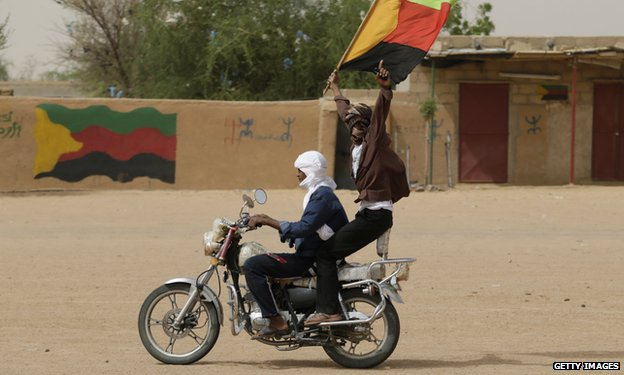 A Tuareg man waves the flag of the National Movement for the Liberation of Azawad (MNLA) in Kidal, northern Mali.