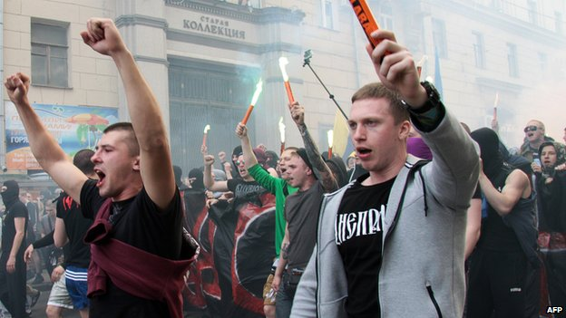 Fans of Ukrainian Football Club Metalist and Football Club Dnipro, in normal times implacable enemies, gather during a march to support a united Ukraine on April 27