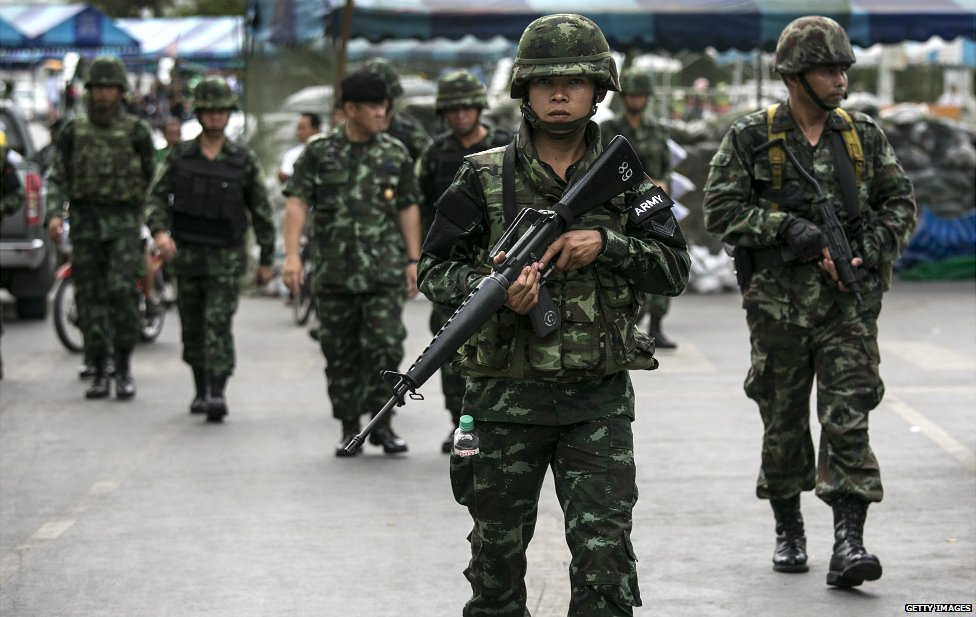 Thai soldiers walk through a market in central Bangkok - 23 May 2014