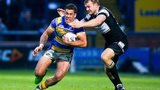 Leeds' Joel Moon is tackled by Hull FC's Liam Colbon