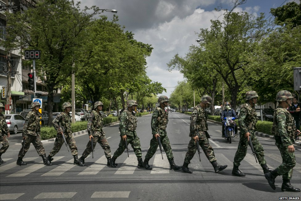 A line of Thai soldiers march over a crossing on a street in central Bangkok - 23 May 2014