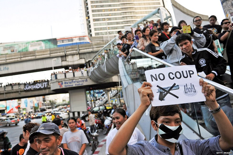 A crowd gathers on a street in central Bangkok to protest the military coup in Thailand - 23 May 2014