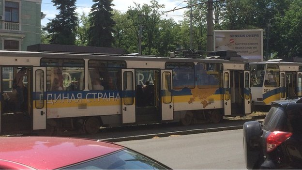 """A tram with """"United country"""" logo"""