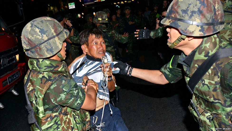 A protester is dragged away by Thai army soldiers after taking part in an  anti-coup rally in Bangkok - 23 May 2014