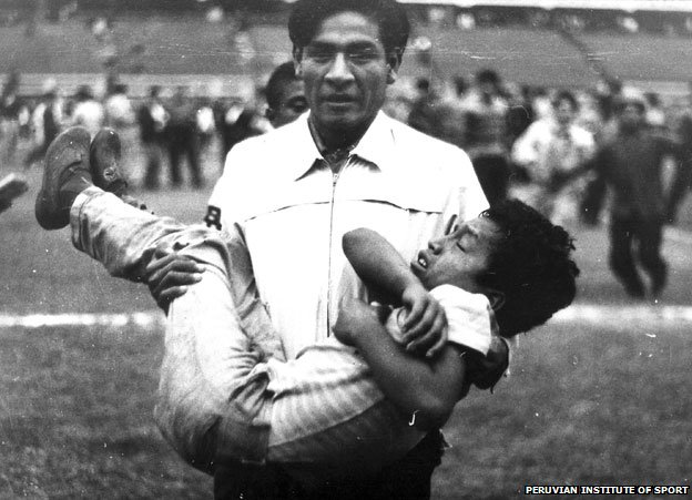Man carrying injured boy