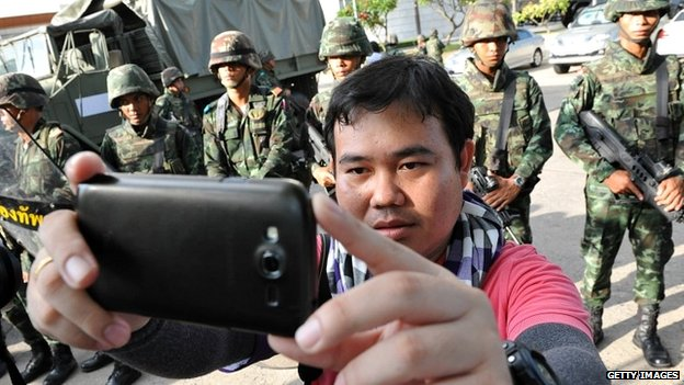 "A man takes a ""selfie"" with Thai soldiers in Bangkok - 22 May 2014"