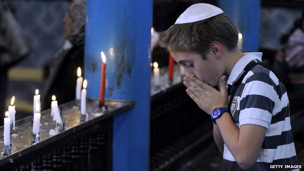 Jewish boy praying at a synagogue in Tunisia