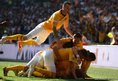 Ryan Donaldson of Cambridge United celebrates his goal with team mates