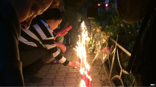 Mourners at memorial for Xinjiang attack victims, Urumqi (23 May)