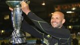 Northampton Saints'  Jim Mallinder lifts the Amlin Challenge Cup