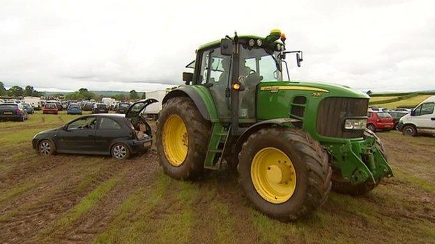 Tractor pulls car