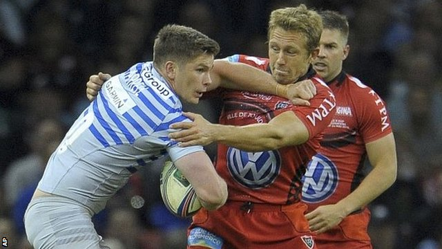 Owen Farrell of Saracens tries to make headway against Jonny Wilkinson