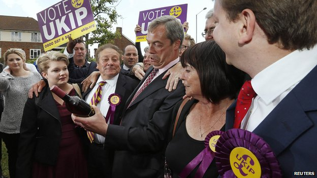 Nigel Farage receiving a bottle of wine from a supporter in South Ockendon