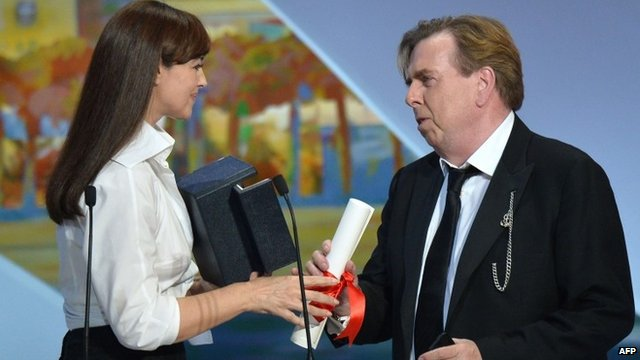 Timothy Spall accepts his prize from Monica Bellucci