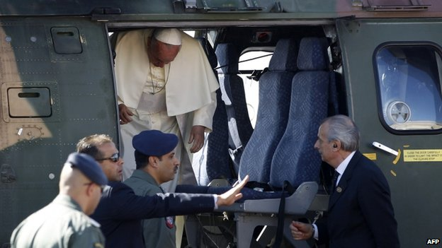 Pope Francis disembarks a Jordanian military helicopter