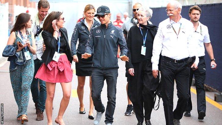 Nico Rosberg (centre) arrives at the Monaco Grand Prix