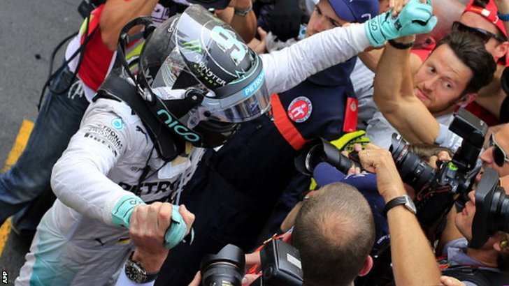 Nico Rosberg celebrates with his pit crew after winning