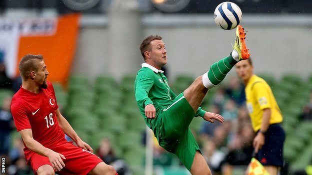 Caner Erkin watches Aiden McGeady in action