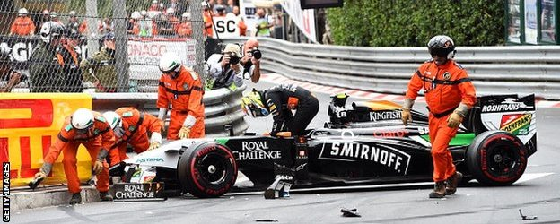 Sergio Perez gets out of his car