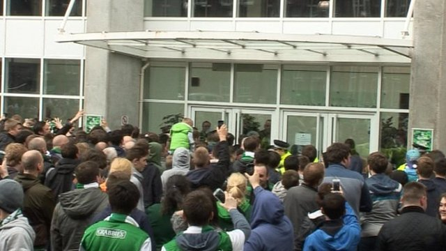 A group of Hibs fans protest after relegation from the Scottish Premiership