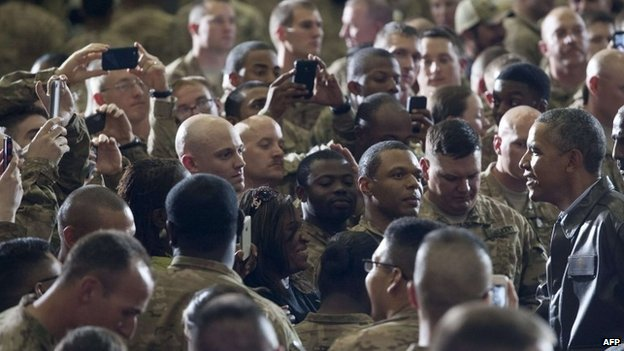 Barack Obama greets US troops during a surprise visit to Bagram Air Field, north of Kabul, Afghanistan, 25 May 2014