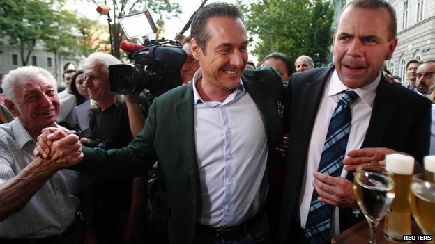 Head of Austria's far-right Freedom Party Heinz-Christian Strache (c) and top candidate Harald Vilimsky (r) celebrate in Vienna 25 May, 2014.