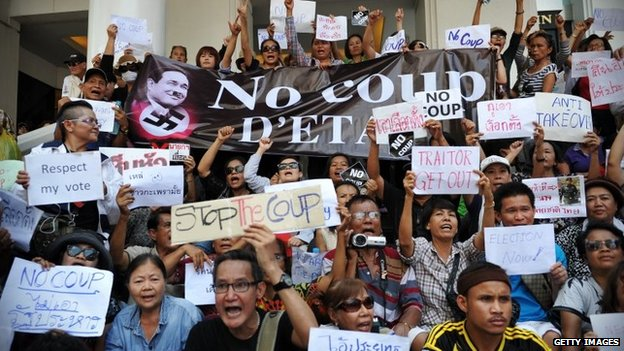 Protesters chant slogans during a city centre anti-coup rally on 25 May 2014 in Bangkok, Thailand
