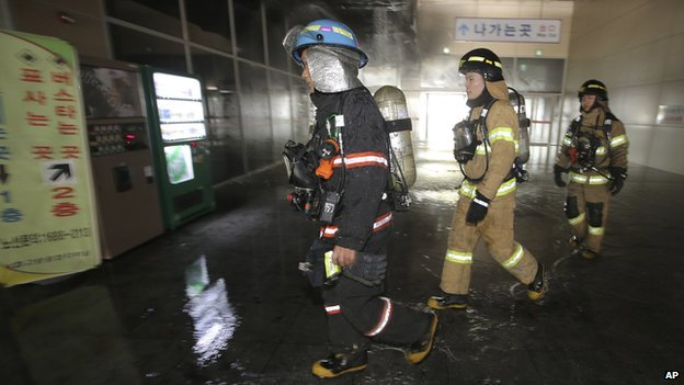 South Korean firefighters arrive at a bus terminal at Goyang, north of Seoul, South Korea, on Monday, 26 May, 2014