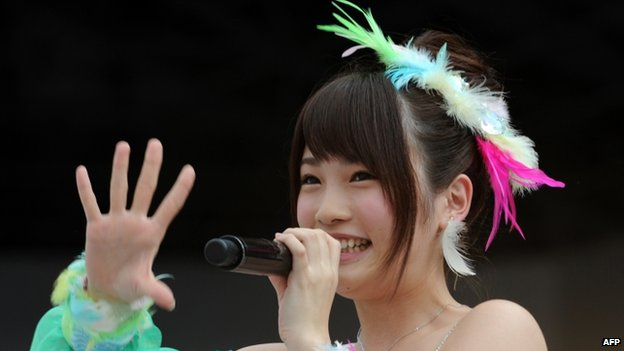 This picture taken on 8 June 2013 shows Japanese girls' pop group AKB48 member Rina Kawaei during the group's concert at the Yokohama stadium.