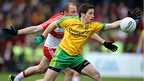 Derry's Sean Leo McGoldrick in action against Darach O'Connor of Donegal