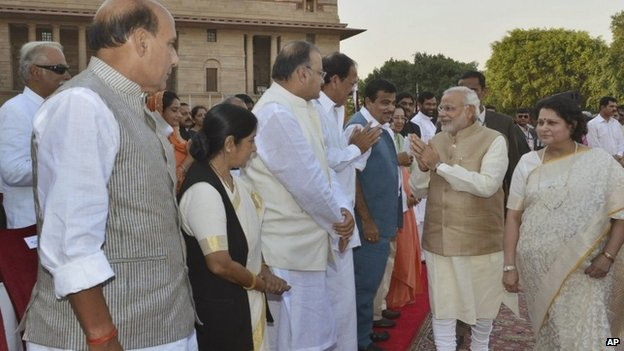 Narendra Modi, second right, greets other leaders upon arrival for his inauguration in New Delhi, India, Monday, May 26, 2014.