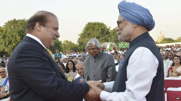 "India""s outgoing Prime Minister Manmohan Singh, right, greets Pakistani Prime Minister Nawaz Sharif, left, as former Indian president A P J Abdul Kalam, center, watches during the inauguration of new prime minister Narendra Modi in New Delhi, India, Monday, May 26, 2014"
