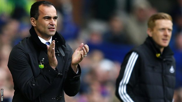 Everton manager Roberto Martinez with current Swansea City manager Garry Monk