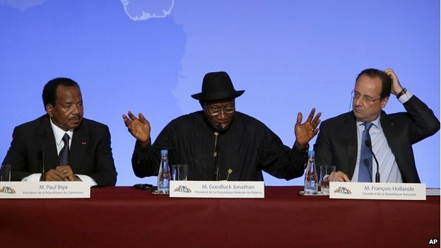 Nigerian President Goodluck Jonathan sits alongside Cameroon President Paul Biya, left, and French President Francois Hollande at a summit at the Elysee Palace in Paris - 17 May 2014